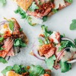 open faced roast beef sandwiches with baby arugula and pesto rosso