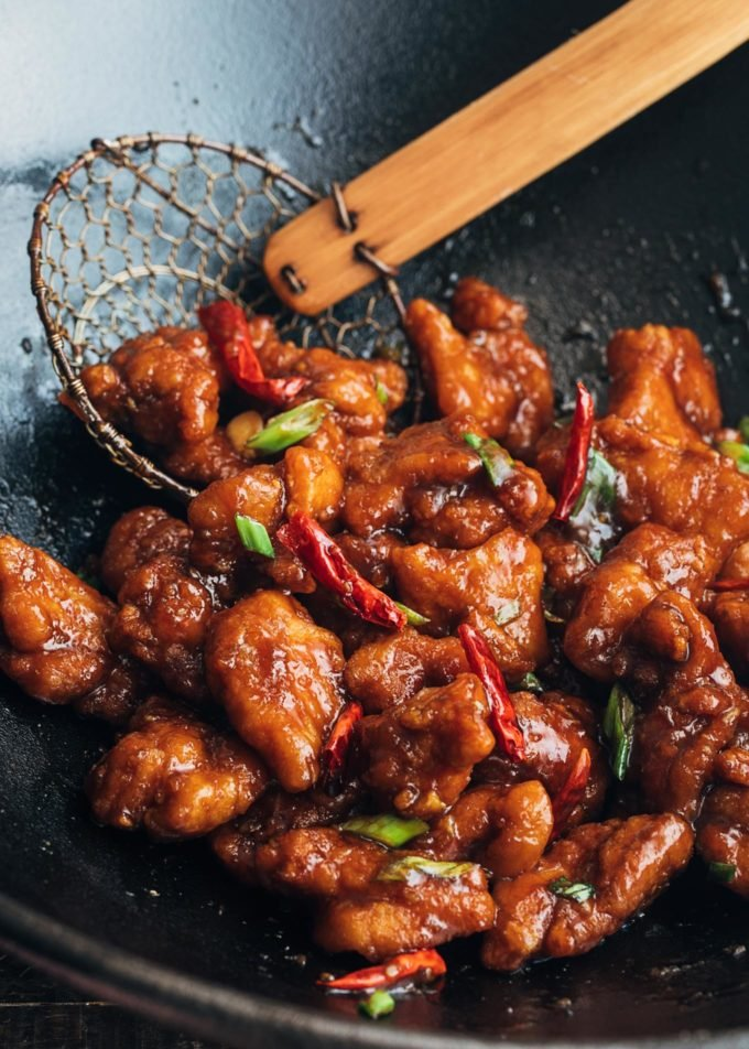 General Tso's chicken with dried red chilies in a wok