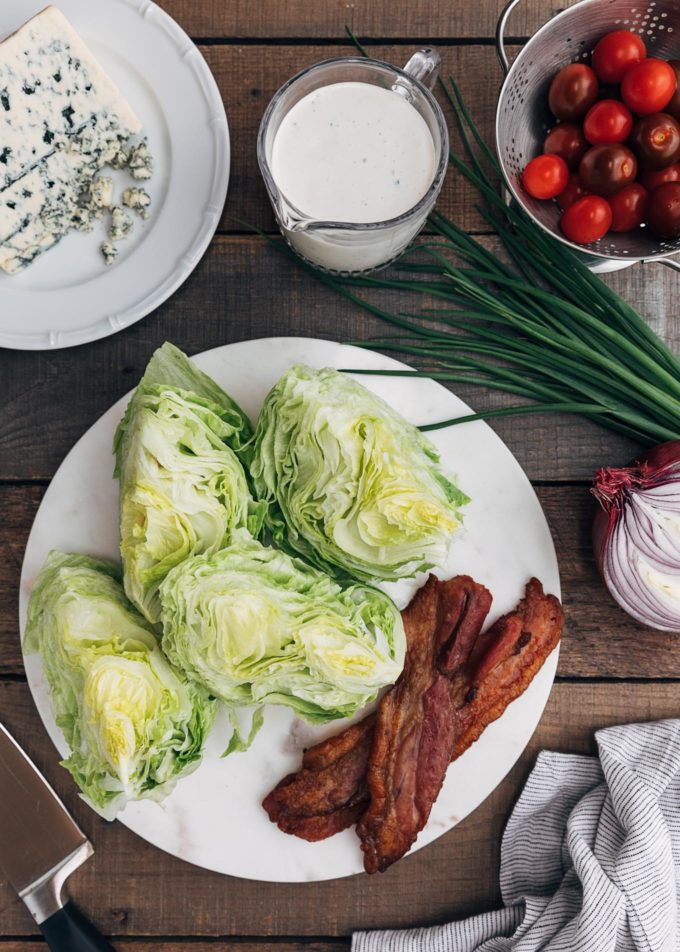wedges of iceberg lettuce, blue cheese, and bacon for wedge salad