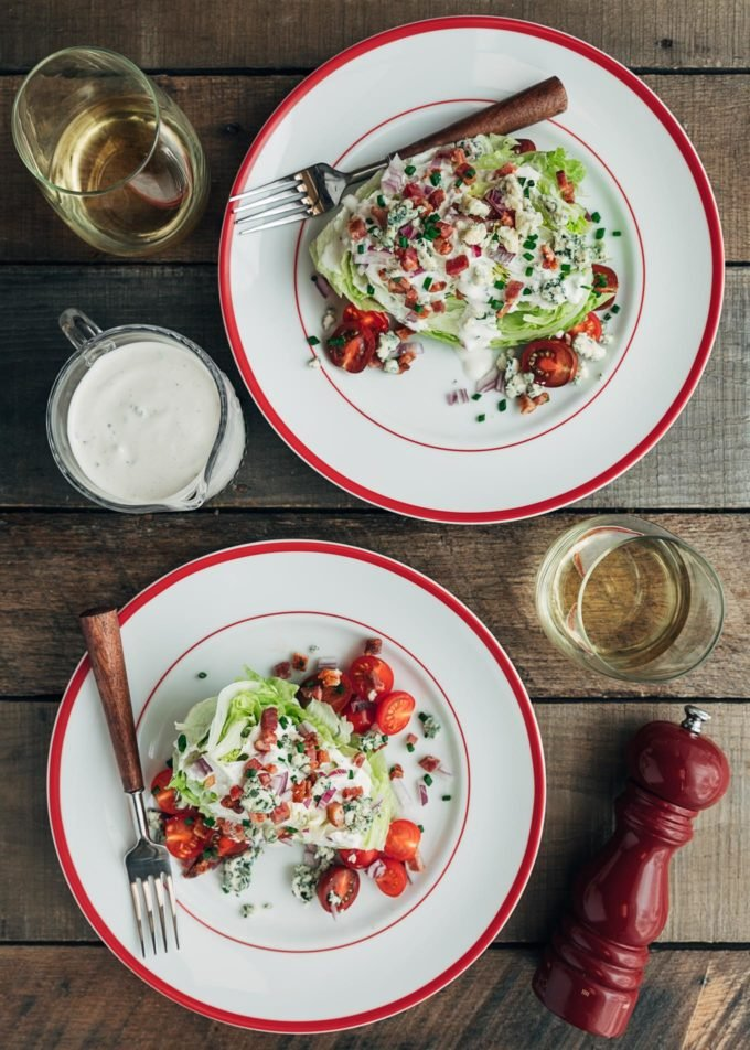 overhead view of plated wedge salads with blue cheese dressing