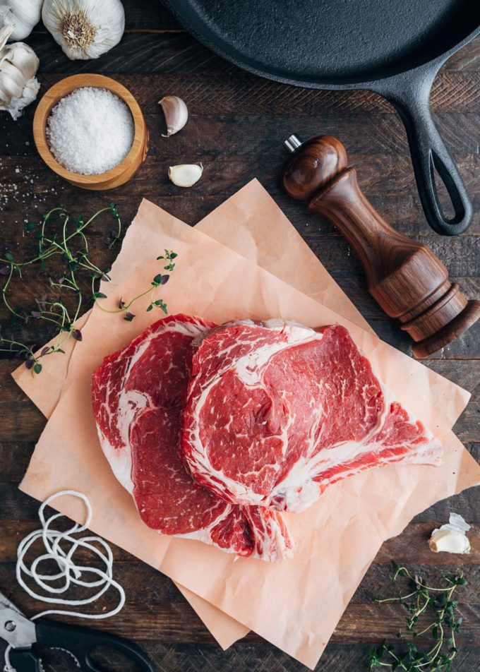 Certified Angus Beef ribeye steaks on butcher paper