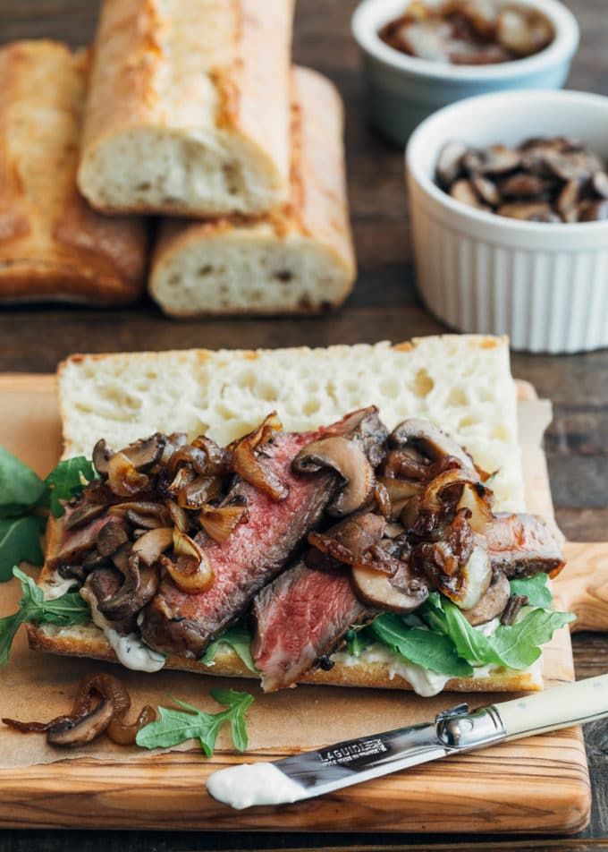 open faced steak sandwich with sautéed mushrooms and caramelized onions