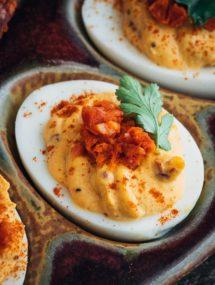 closeup of chipotle deviled eggs with minced chorizo and cilantro