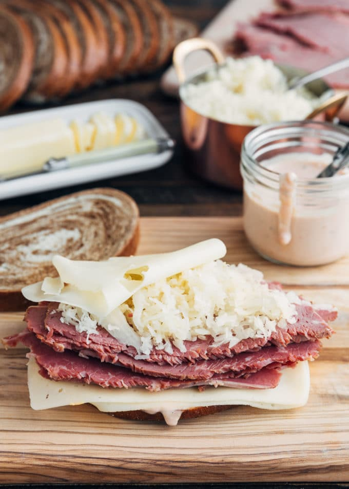 reuben sandwich on a board before grilling