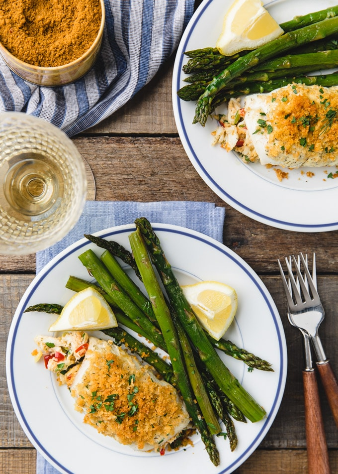 {sponsored} overhead photo of crab stuffed flounder on white plates with asparagus