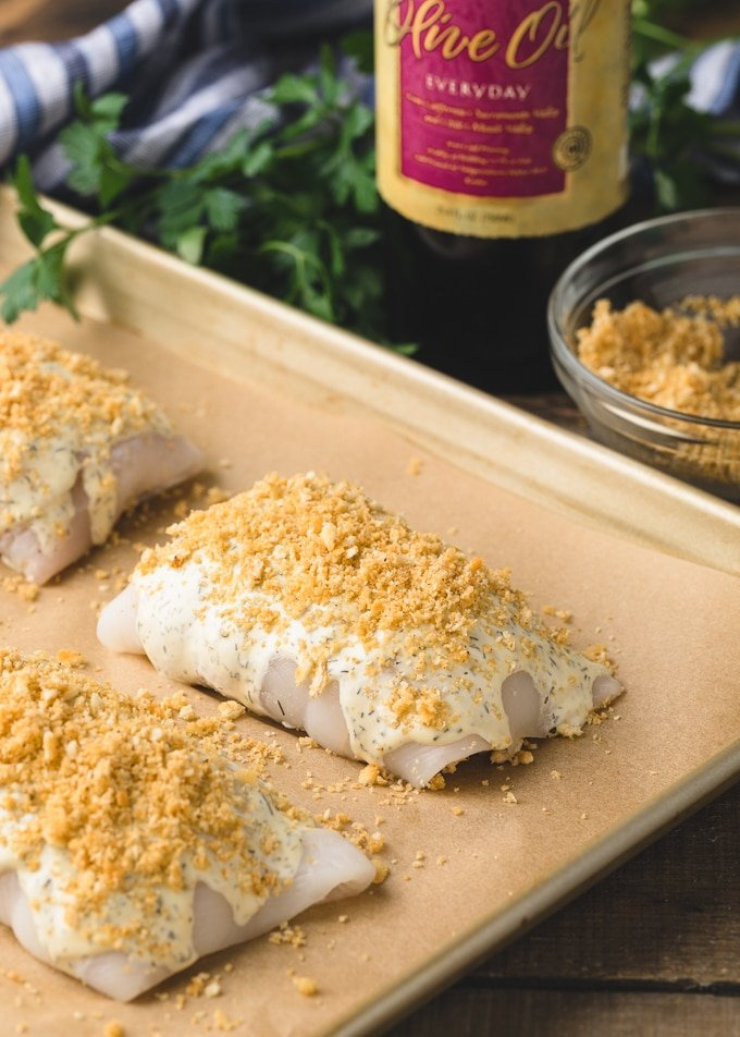 {sponsored} uncooked stuffed flounder bundles on a baking sheet