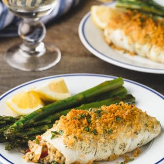 {sponsored} crab stuffed flounder on blue-rimmed white plates with asparagus