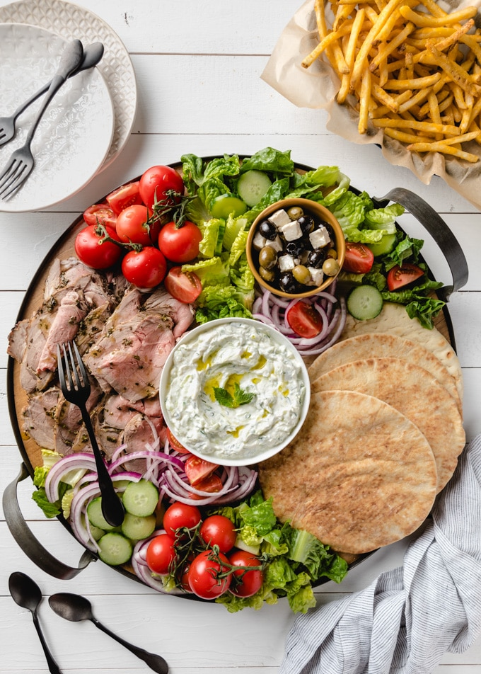 overhead of round board with fixings for lamb pitas