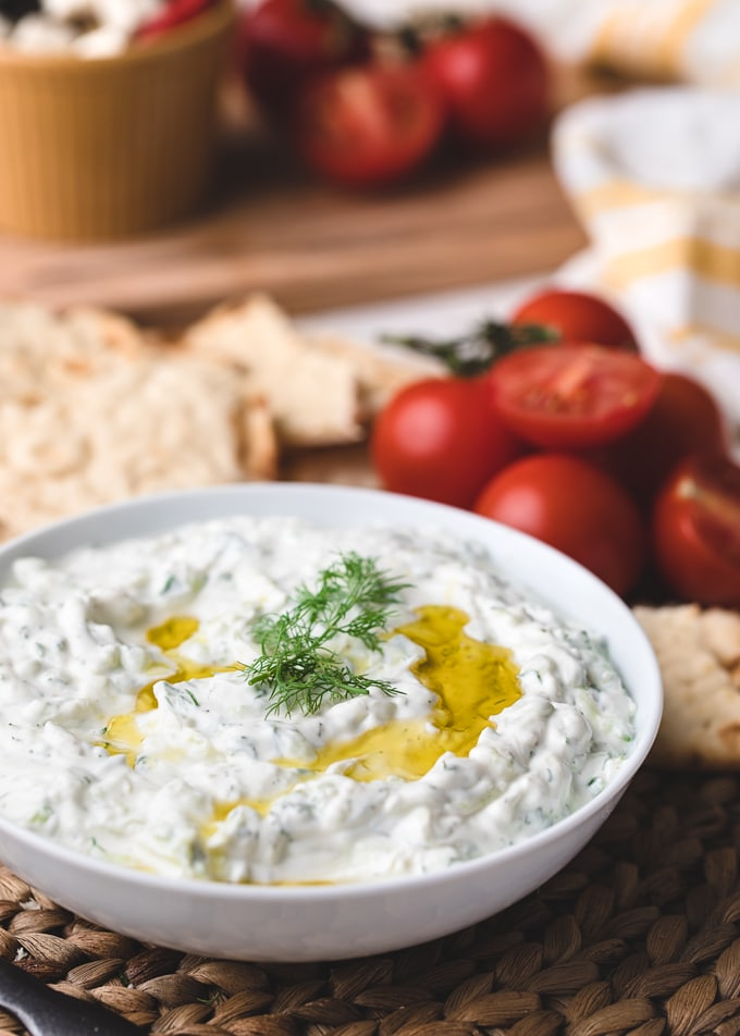 closeup of a bowl of homemade tzatziki sauce drizzled with olive oil