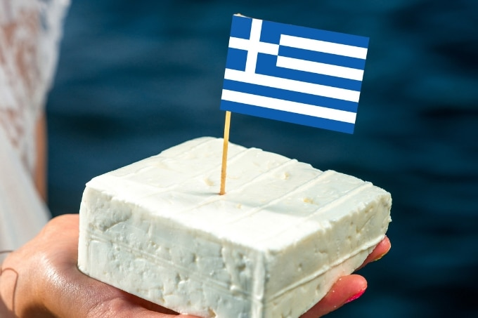 block of feta with a paper Greek flag