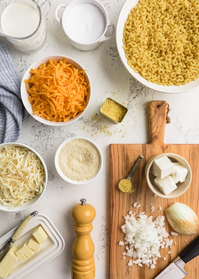 overhead of ingredients for making classic macaroni and cheese in a pressure cooker