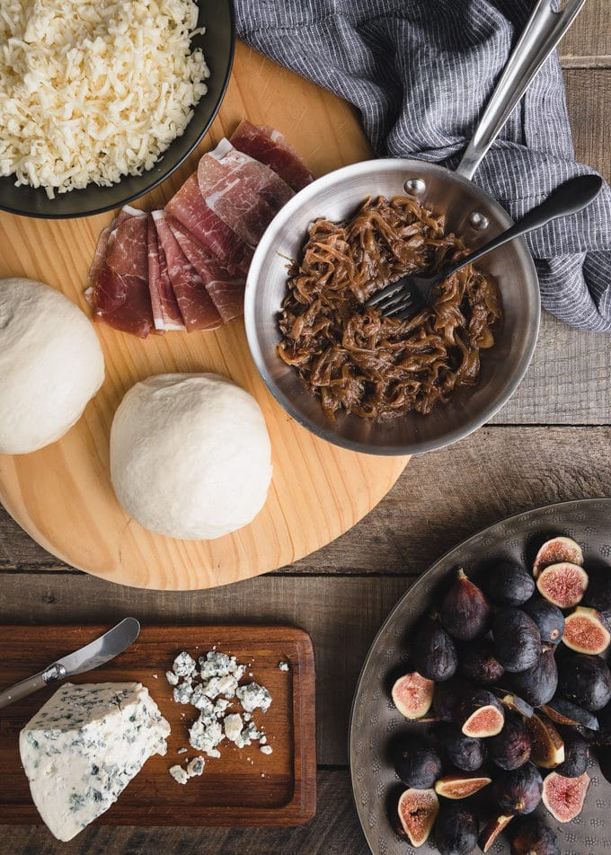overhead view of ingredients to make gorgonzola and fig pizza
