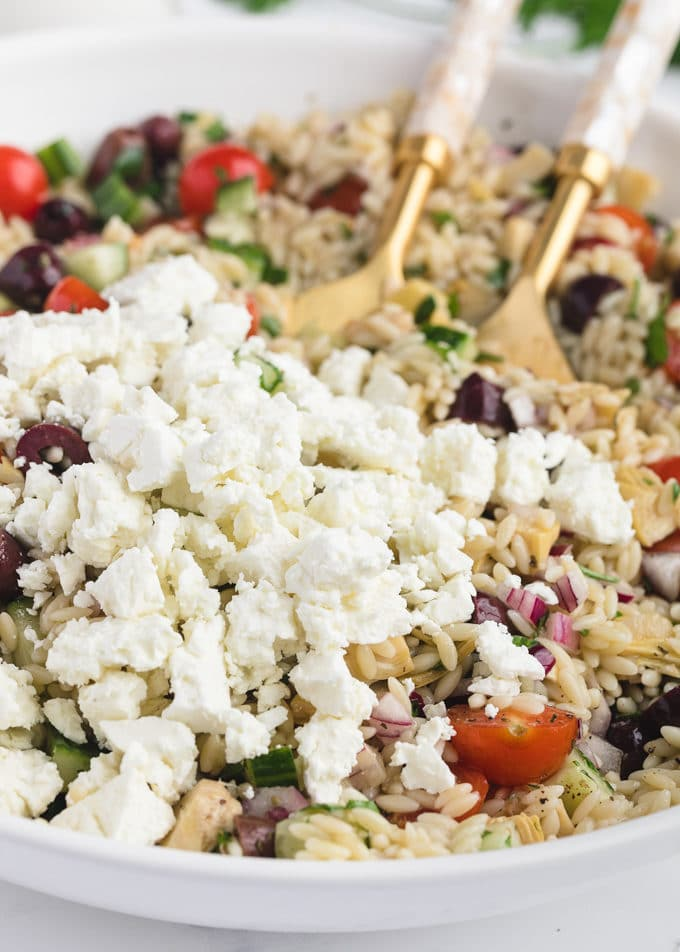 closeup of crumbled Greek Feta in a bowl of pasta salad