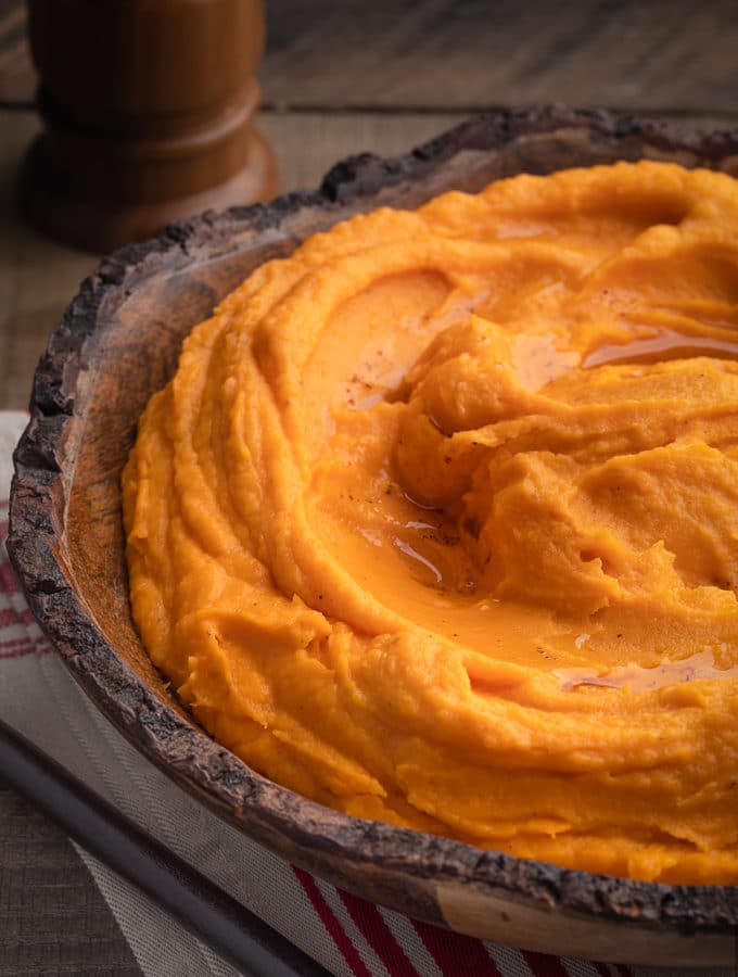 brown butter whipped sweet potatoes in a wood serving bowl