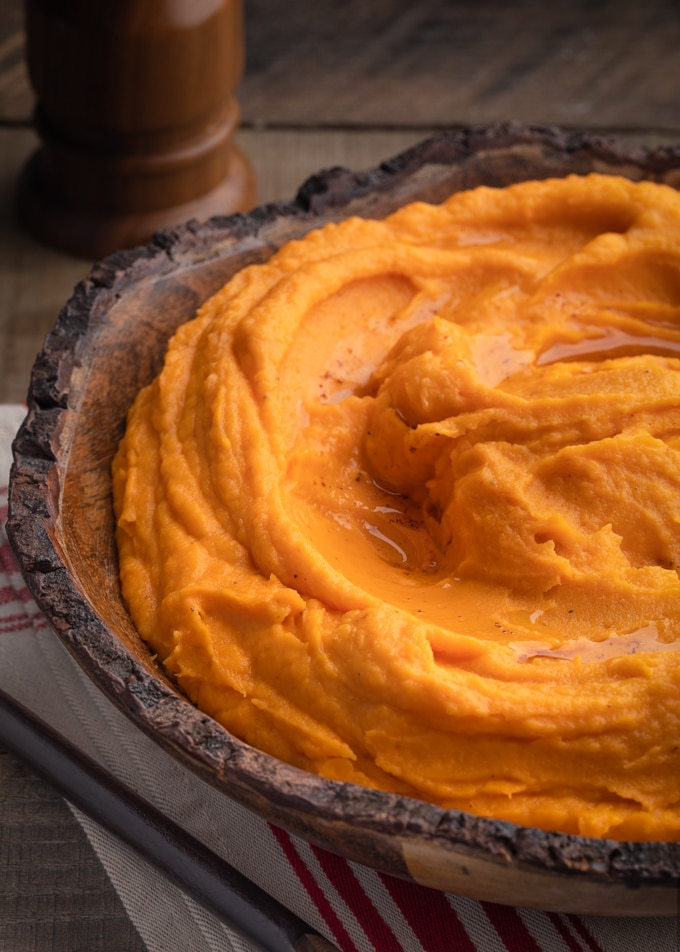brown butter whipped sweet potatoes in a wooden bowl