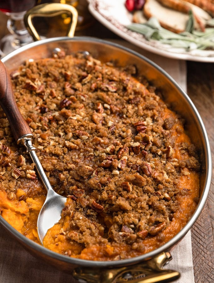 sweet potato casserole with pecan streusel topping in a copper gratin dish