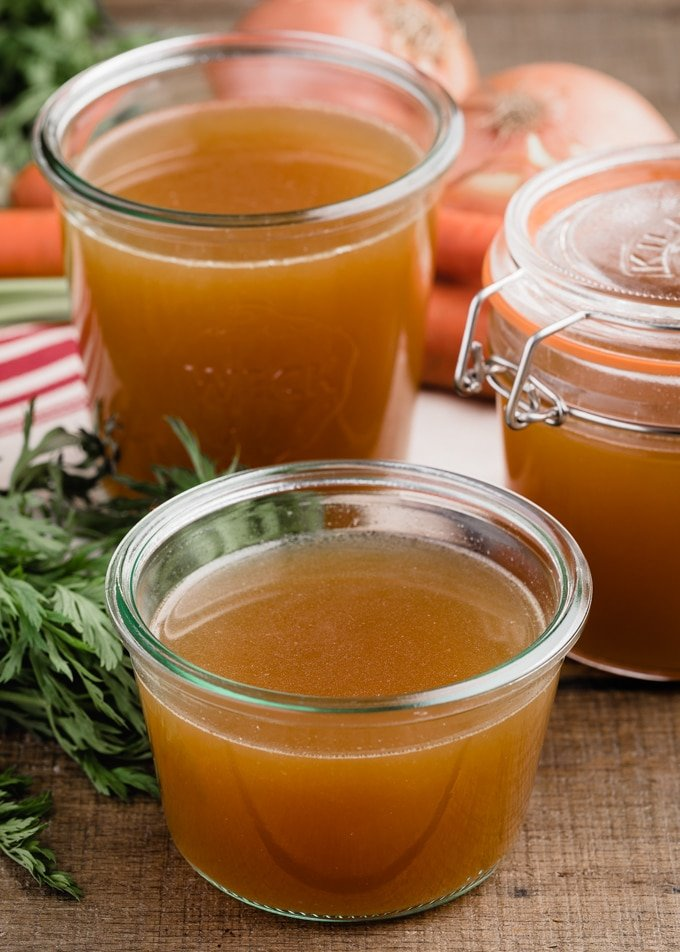 homemade turkey stock in three glass jars