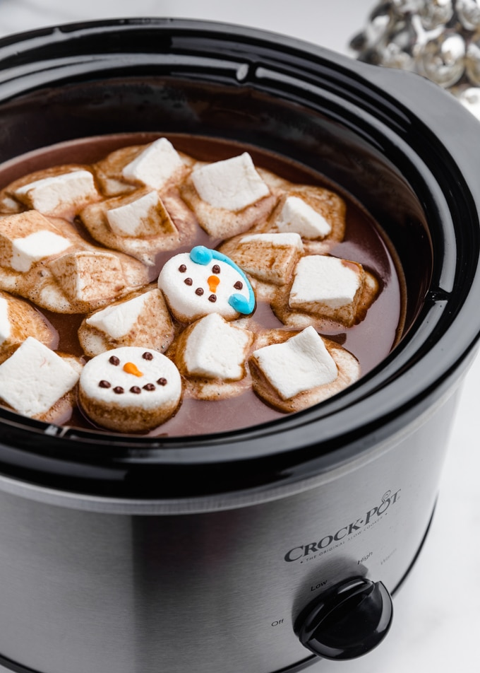 hot chocolate in a slow cooker with melted marshmallows on top