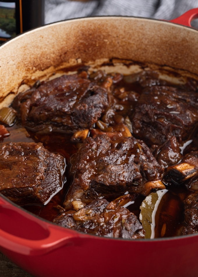 stout beer braised short ribs in a dutch oven