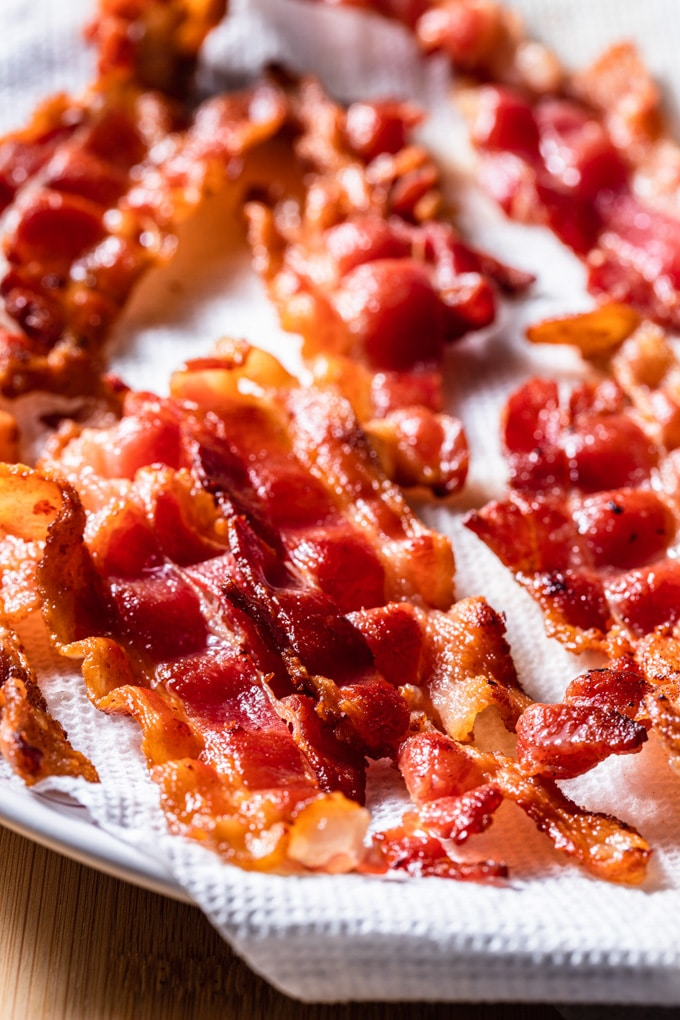 crisp cooked bacon on a paper towel lined plate