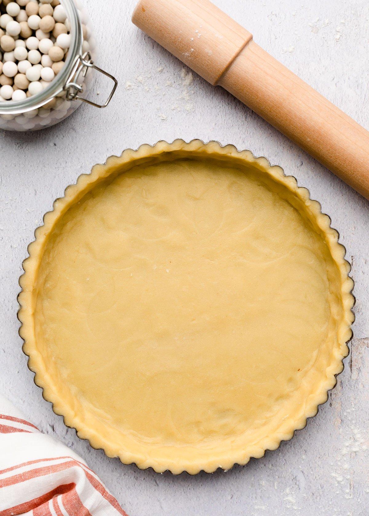unbaked pate sablee in a tart pan
