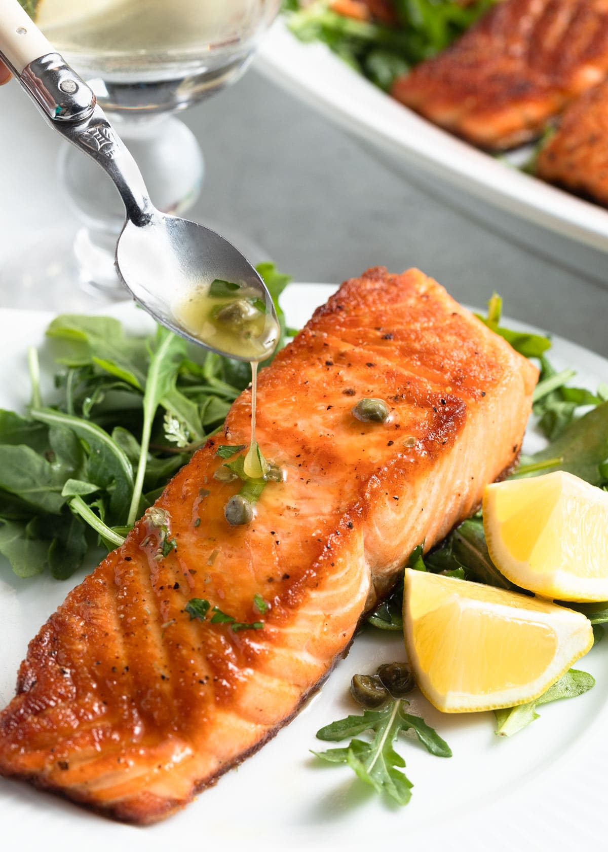 pan seared salmon fillet drizzled with lemon caper sauce