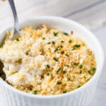 gorgonzola macaroni and cheese in a white ramekin with a spoon